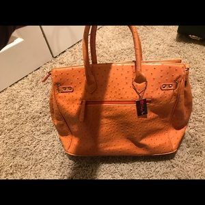 Penelope Anne orange ostrich bag